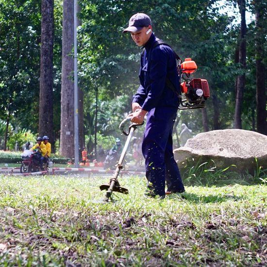 Full length of man standing in yard