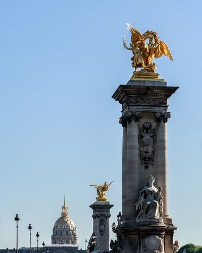 Statue in paris against clear sky