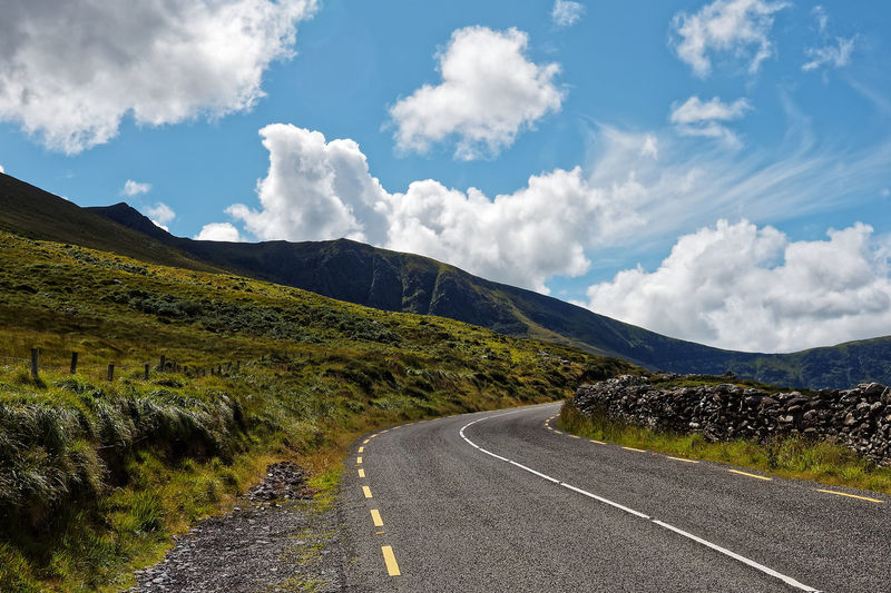 Kerry Ireland Wild Atlantic Way Beauty In Nature Cloud - Sky Curve Day Landscape Mountain Nature No People Outdoors Ring Of Kerry Road Road Marking Scenics Sky The Way Forward Tranquil Scene Tranquility Transportation White Line Winding Road