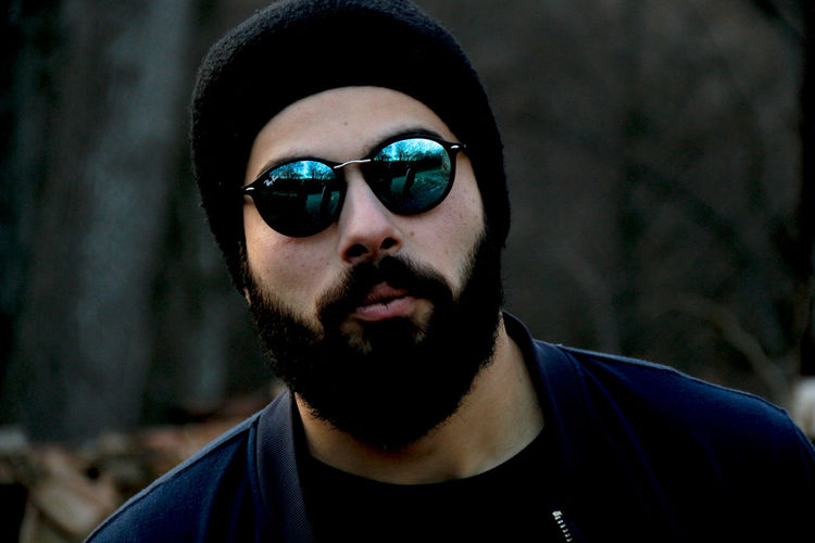 Close-up portrait of bearded man wearing sunglasses