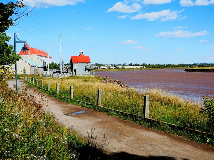 Red River Roaming ~ Sky Day Outdoors Built Structure Cloud - Sky No People Water Building Exterior Architecture Moncton New Brunswick, Canada Ebb And Flow River View The Week On EyeEm Small Town Life Riverfront Beauty In Nature Vacation Destination Muddy River Dirt Roads River Walk