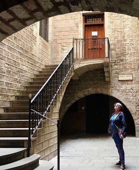 Full length of woman standing on arch bridge