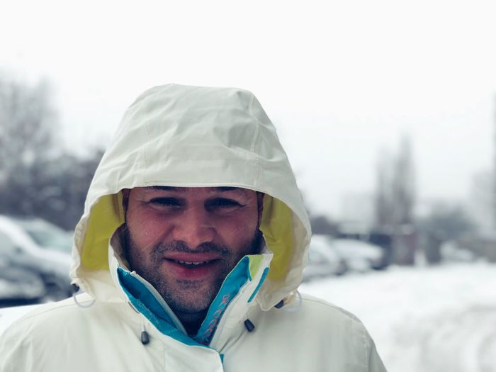 Portrait Of A Smiling Man During Winter