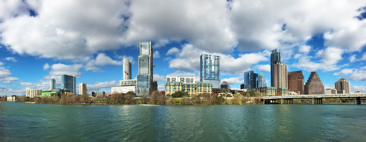 Panorama of the Austin, Texas, skyline Architecture Austin Blue Building Exterior Built Structure City Cityscape Cloud Cloud - Sky Cloudy Day Outdoors Reflection Rippled River Sky Skyscraper Texas Water Waterfront