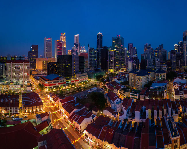 Aerial view of illuminated chinatown buildings in singapore city at night
