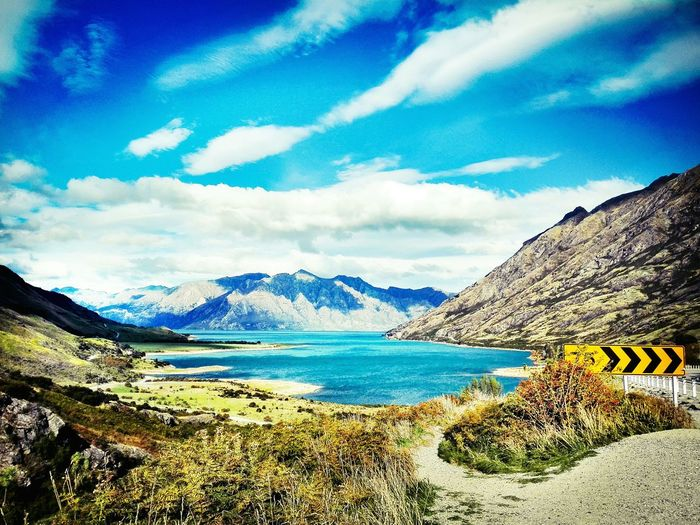 Great views at New Zealands roads - just pull over and enjoy! Street Lake Wanaka Wanakalake New Zealand New Zealand Scenery Traveling Travel Destinations Travel Photography Travel Lake Lake View View Landscape Mountain Water Sea Blue Sky Mountain Range Cloud - Sky Landscape Rock Formation Rocky Mountains Rock Geology Coast Rocky Coastline Cliff Arid Landscape