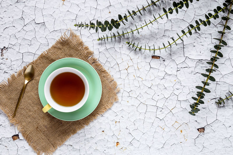 Food And Drink Cup Drink Refreshment Mug High Angle View Table Freshness Tea - Hot Drink Crockery Tea Hot Drink Saucer Food No People Still Life Tea Cup Day Plant Indoors  Tiled Floor