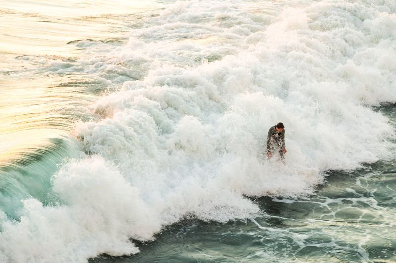High angle view of surfer on sea