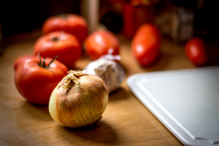 Close-Up Of Tomatoes And Onions On Table