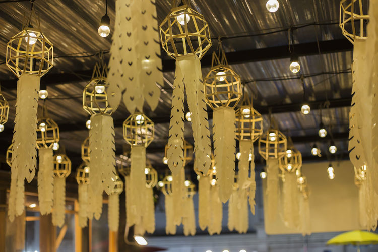 Low angle view of illuminated lights hanging from ceiling