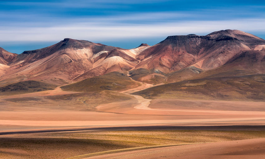 Rainbow Mountain Bolivia Rainbow Mountain Uyuni Altiplano Arid Climate Beauty In Nature Climate Cloud - Sky Day Desert Environment Idyllic Land Landscape Mountain Mountain Range Nature No People Non-urban Scene Outdoors Rock Formation Scenics - Nature Sky Tranquil Scene Tranquility