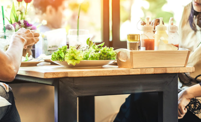 Midsection of food on table at restaurant