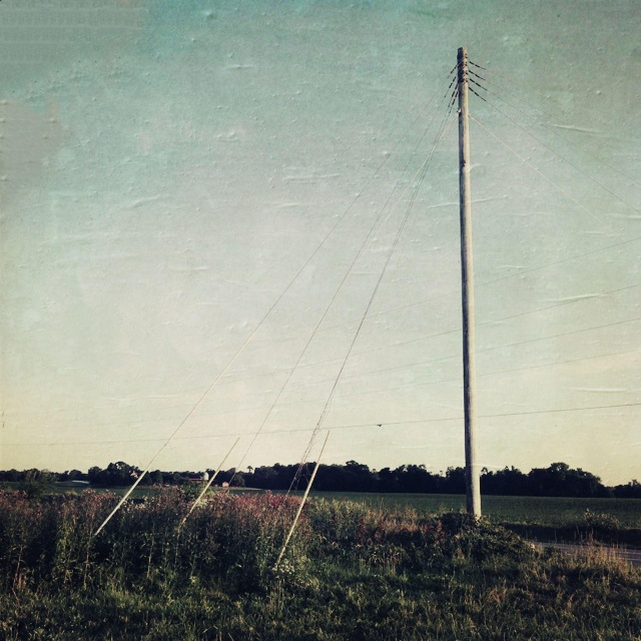 field, fuel and power generation, grass, electricity pylon, landscape, technology, wind turbine, alternative energy, electricity, power line, sky, environmental conservation, renewable energy, tranquility, wind power, power supply, windmill, nature, tranquil scene, rural scene