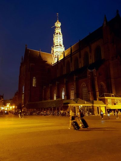Night History Architecture Illuminated Travel Destinations People Outdoors Haarlem Travelling Suitcases Luggage Trolleys Luggage Blue Hour Old Town Historical Building Historical Monuments Church Square Marketplace Let's Go. Together.
