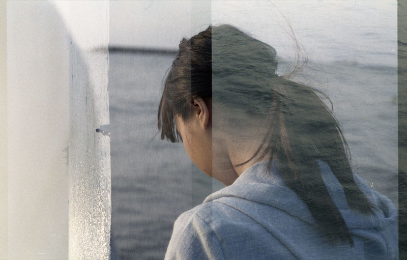 Multiple Exposure Of Woman And Man By Sea