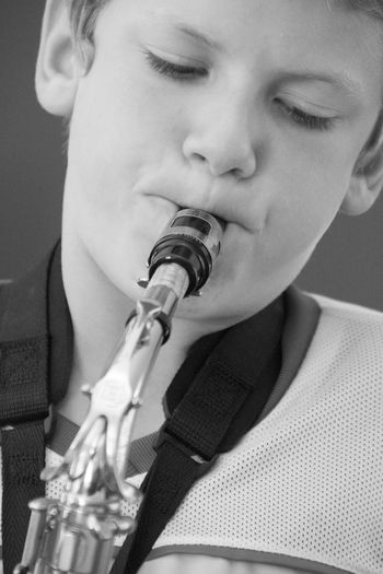 Close-Up Of Boy Playing Saxophone