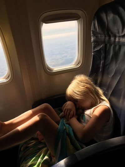 Girl sleeping in airplane