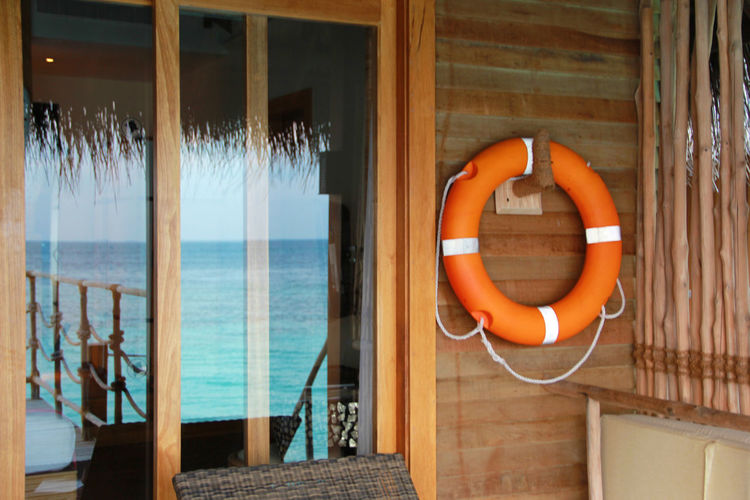 Day Orange Color Cabin Wood House Life Buoy Buoy Life Ring Wood Cabin Window Sea Reflection Balcony Hanging No People Safety Protection