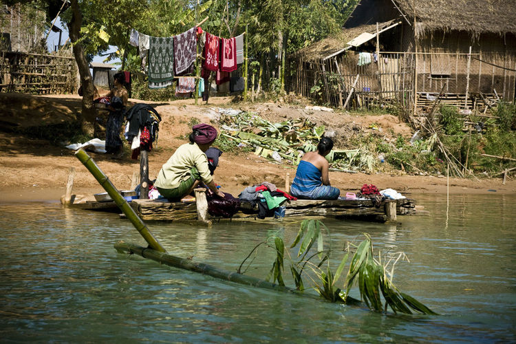 Adult Architecture Burma Burma People Check This Out Day Fishing Net Inle Lake Living On Water Men Mode Of Transport Myanmar Nautical Vessel Oar Outdoors People Real People Rowing Togetherness Traditional Transportation Tree Water Women Wooden Raft