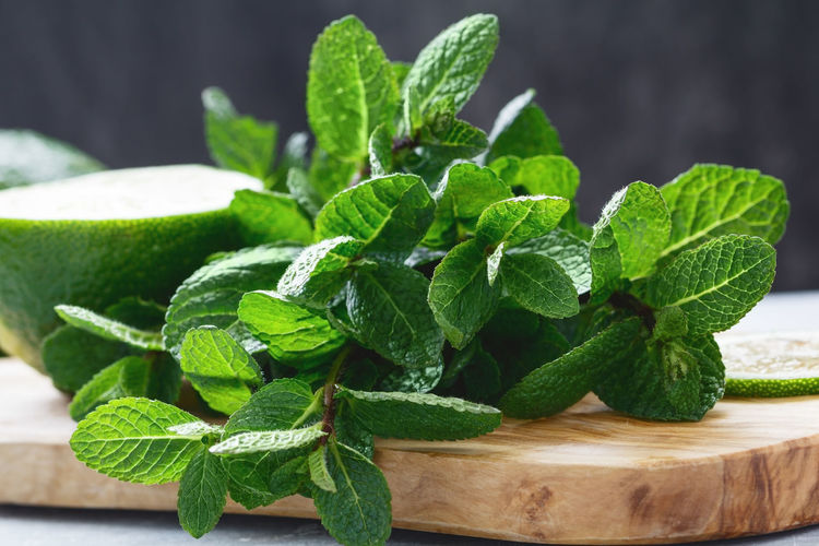 Close-Up Of Mint On Cutting Board At Table