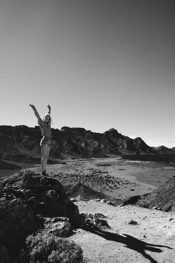 Volcano Mount Teide Canary Islands Tenerife Blackandwhite Full Length Arms Raised Balance Standing Beach Outdoors Leisure Activity One Person Nature Real People Day Clear Sky Beauty In Nature Young Adult Men Young Women Sky Adults Only Adult People An Eye For Travel
