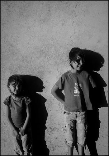 Against The Light Against The Wall B&w Blackandwhite Children Girls Greyscale Monochrome Photography People Profile Shadow Shadows & Lights Side By Side Sidelight Standing Togetherness Two People