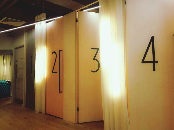 Illuminated No People Indoors  Night Chsnging Rooms Doors Lights Numbers Curtains Shop Shopping Shopping Mall Changing Dark Indoors  Indoor Photography Angles Geometry Geometric Shapes