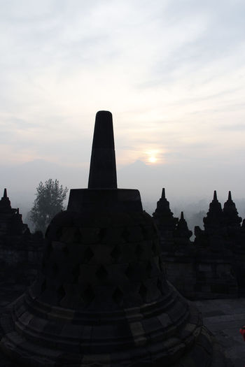 Silhouette Borobudur Temple with the mysteries forest surrounding during sunrise, Yogyakarta, Indonesia Ancient Borobudur Temple Java Yogyakarta Ancient Civilization Architecture Belief Buddhism Built Structure Dawn Fog Forest History Mount Merapi No People Place Of Worship Religion Religious Architecture Sky Spirituality Stone Material Sunrise Sunset The Past Travel