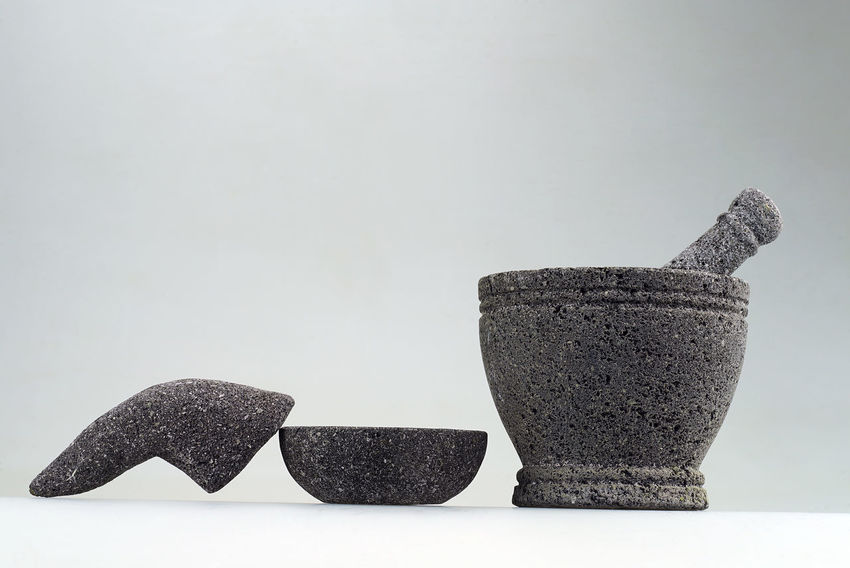 Handmade pestle and mortar from black sand Day Fragility Gray Background Grind Handmade Hanging Out Hard INDONESIA Indoors  Mortar No People Pestle Sand Stone Studio Shot Traditional Utensil White Background