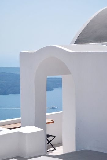 Frames and views Greece Santorini Travel Travel Destinations Santorini, Greece EyeEm Best Shots EyeEm Selects The Week on EyeEm The Traveler - 2018 EyeEm Awards The Great Outdoors - 2018 EyeEm Awards The Architect - 2018 EyeEm Awards Architecture Built Structure Water Sky Day No People Sea Nature Building Exterior Arch White Color Whitewashed Travel Destinations Outdoors Copy Space Architectural Column Modern