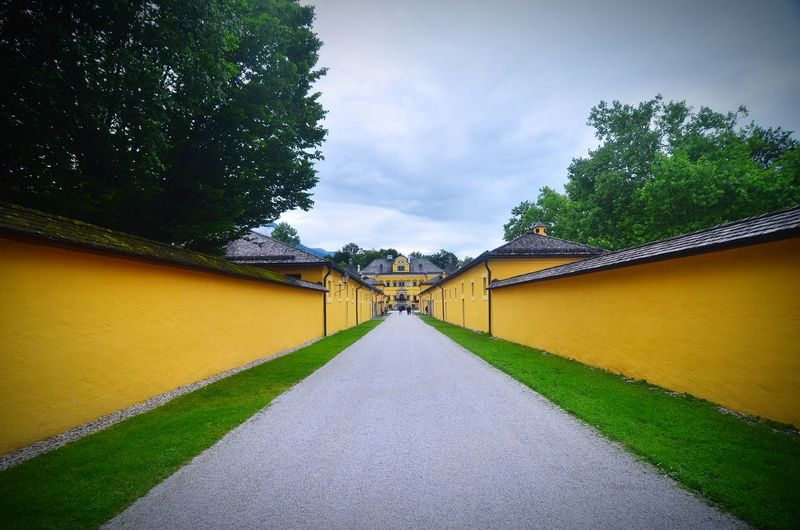 Vanishing into the Schloss Hellbrunn compound wall walls Tourist Attraction Leading Lines diminishing perspective yellow Hellbrunn Palace Austria Royal Garden summer palace heritage palace garden the way forward direction Plant sky built structure Architecture Tree no people va Hypnotic vanishing point Compound Wall Walls Tourist Attraction  Leading Lines Diminishing Perspective Yellow Hellbrunn Palace Austria Royal Garden Summer Palace Heritage Palace Garden The Way Forward Direction Plant Sky Built Structure Architecture Tree No People Outdoors Green Color The Architect - 2018 EyeEm Awards