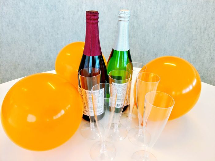 High angle view of champagne bottles with balloons on table