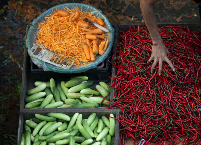Choosing Red Chilli Pepper Abundance Choice Food Food And Drink For Sale Freshness Healthy Eating Heap High Angle View Large Group Of Objects Market Market Stall Occupation Outdoors Red Chili Pepper Retail  Small Business Spice Variation Vegetable