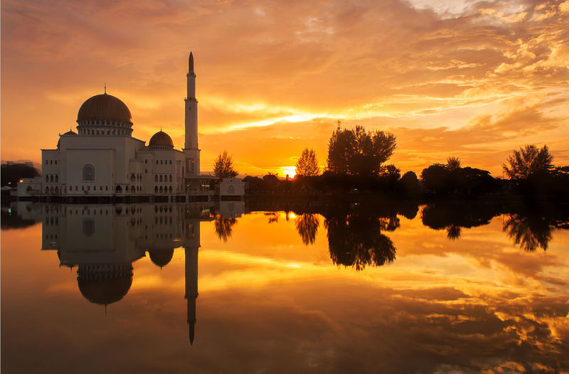 sunrise with mosque reflection