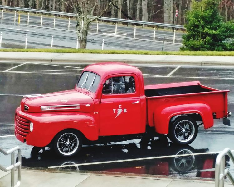 Big Red EyeEm Gallery Cell Phone Photography Rest Stop View Free Way In The Background Ford Truck TCB Elvis Lightning Bolt Rainy Days Winter Old-fashioned Antique Truck Old And New Ford Truck Red Car Water No People Day Outdoors