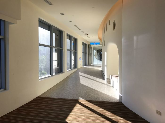 EyeEm Selects Architecture Building Sunlight Corridor Arcade Day No People The Way Forward Indoors  Window Direction Shadow Built Structure Diminishing Perspective Empty Wall - Building Feature Flooring Entrance Door