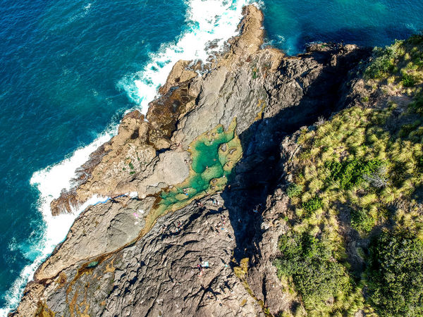 Stunning wide angle aerial drone view of the Mermaid Rock Pools and ocean waves at Matapouri Bay near Whangarei on the North Island of New Zealand. The rock pools are a popular tourist destination. Coastline Drone  Matapouri Bay Nature New Zealand Landscape Tourist Attraction  Travel Travel Photography Wave Aerial View Coast Dji Drone View High Angle View Mermaid Pools Nature Nature_collection New Zealand North Island Ocean Rock - Object Rock Pool Tourism Travel Destinations Whangarei
