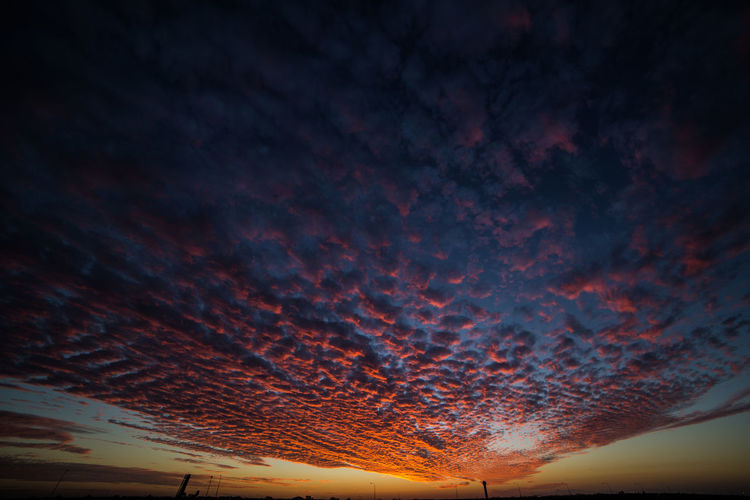 Low angle view of dramatic sky during sunset