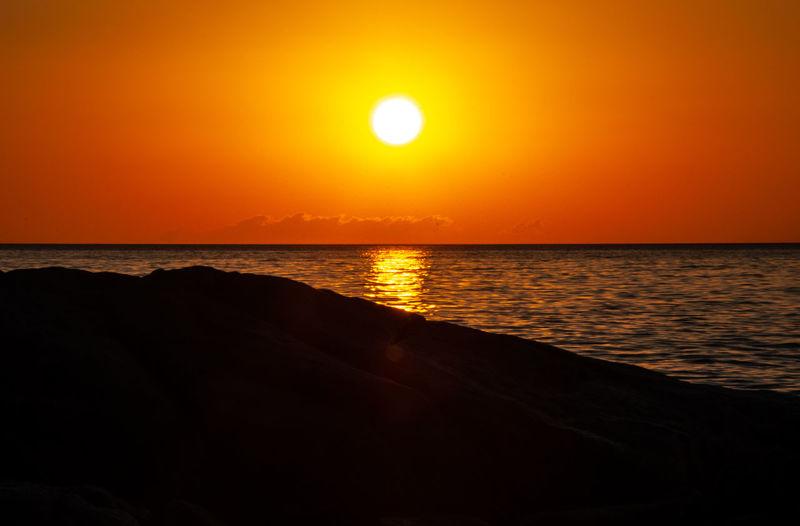 Sunrise over the sea Nikon Orange Beauty In Nature Horizon Horizon Over Water Idyllic Land Nature Nikonphotography No People Non-urban Scene Orange Color Outdoors Reflection Scenics - Nature Sea Sihouette  Sky Sun Sunlight Sunrise Sunset Tranquil Scene Tranquility Water Capture Tomorrow
