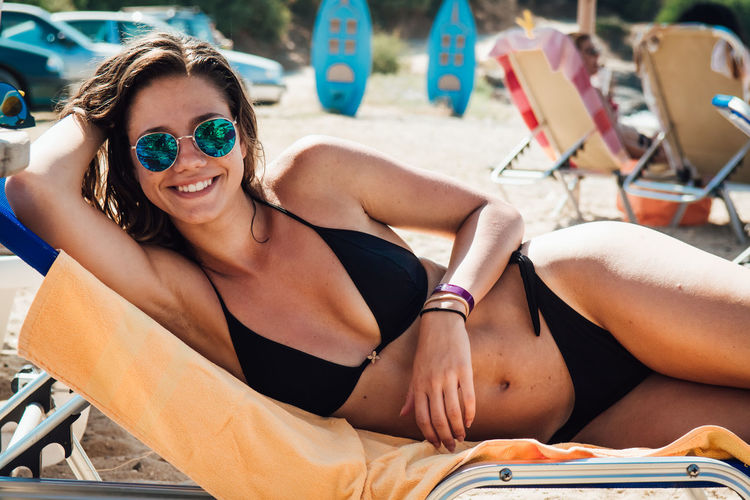 Beach Beautiful Woman Bikini Day Happiness Leisure Activity Lifestyles Looking At Camera One Person Outdoors Portrait Real People Sand Sitting Smiling Summer Sunglasses Sunlight Vacations Young Adult Young Women The Portraitist - 2018 EyeEm Awards The Great Outdoors - 2018 EyeEm Awards The Traveler - 2018 EyeEm Awards
