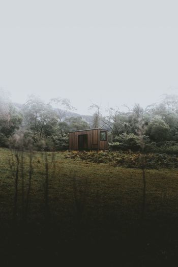 @jonagrey | Coralie Cabing by Unyoked in the Kangaroo Valley Wilderness Mountain Cabin In The Woods Cabinporn Cabin Unyoked Kangaroo Valley Sky Plant Nature Field Clear Sky No People Land