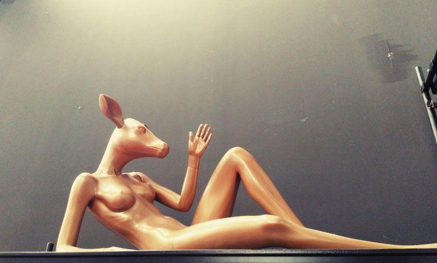 Lionesa Co work space Deed Human Deer Head Deer Sculpture Deer Woman Golden Dee Layed Down Deer Sculpture Dee Statue