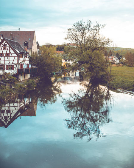 View to the historic city of Harburg in Bavaria over the river Wörnitz. Bavaria Bayern Deutschland Germany Harburg In Schwaben Built Structure Architecture Building Exterior Water Building Tree Sky Nature House Day Plant No People Cloud - Sky Outdoors Reflection Wörnitz Waterfront Beauty In Nature River