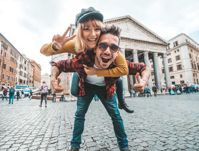 Portrait of happy friends on street in city