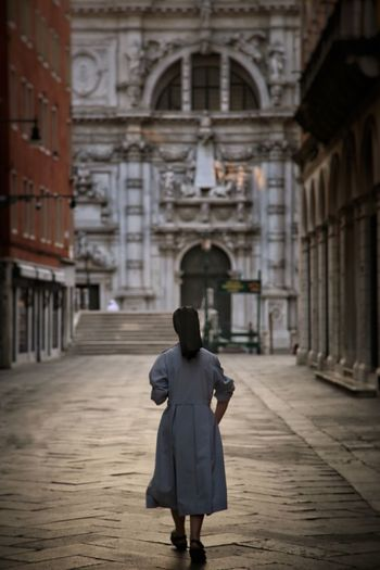 Rear view of woman walking on street