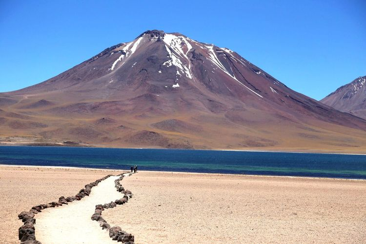 River and mountains against clear sky on sunny day at atacama desert