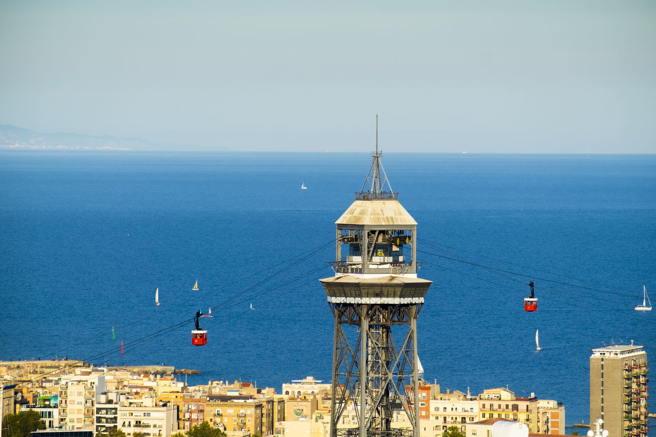 High Angle View Of Overhead Cable Car At Catalonia By Sea