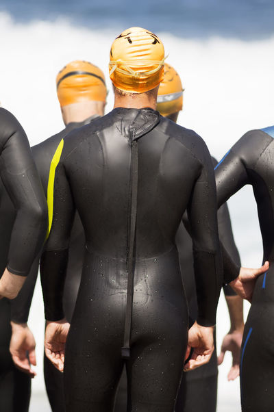 triathlon participants , triathletes , in swiming portion of race Athlete Athletes Beach Sports Beachphotography Compete Competition Competitive Sport Men Race Running Sea Sport Beach Sportman Sportmen Sprint Swim Swimming Triathlete Triathletes TRIATHLON