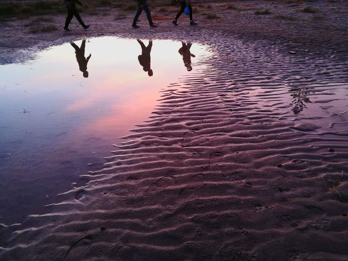 Walking on a dream. Lost In The Landscape Reflection Water Wet Sunset Landscape Silouette Silouette & Sky Puddle Sky Purple Sand Sand & Sea Walking On The Beach