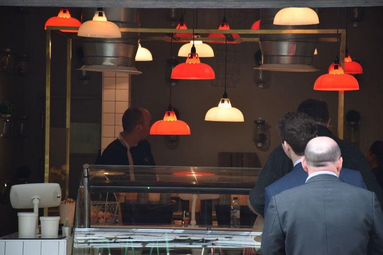 Rear view of people in restauratn